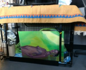Bad painting put to good use in front of kitty litter box